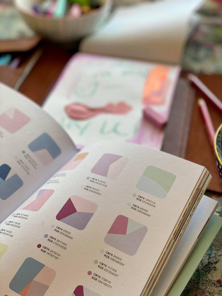 A close up photo of a color palette book