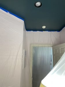 taped off walls and ceiling for painting