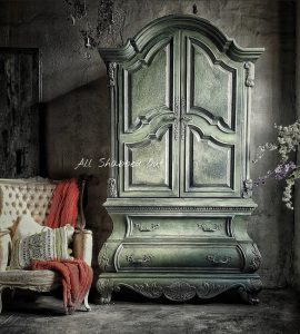 A light green distressed wardrobe by Quitta Allen