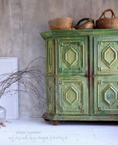A textured and layered piece of green furniture with lots of dark and light tones.