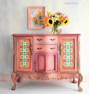 pink sideboard with folk art painted accents