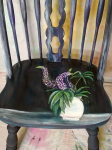 Jacqueline Arsovsky finger painted lupins on a chair