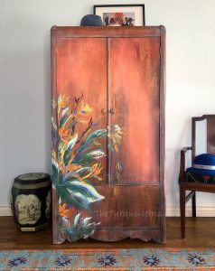 Rust colored wardrobe with hand painted flowers